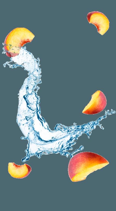 אפרסקים ושפריץ של מים